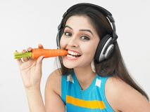 Asian woman eating a carrot Royalty Free Stock Image