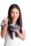 Asian woman eating cereal Royalty Free Stock Image