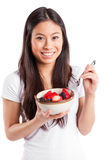 Asian woman eating fruit Royalty Free Stock Images