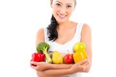Asian woman eating fruit Stock Photos