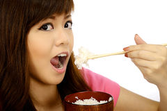 Asian Woman Eating Japanese Food Stock Image