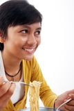 Asian woman eating noodle Stock Photo