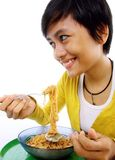Asian woman eating noodle Stock Images