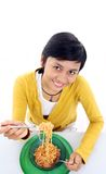Asian woman eating noodle Royalty Free Stock Image