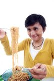 Asian woman eating noodle Royalty Free Stock Photography