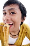 Asian woman eating noodle Stock Photography