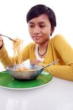 Asian woman eating noodle Royalty Free Stock Photo