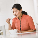 Asian woman eating rice. Royalty Free Stock Image