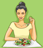 Asian woman eating salad Stock Photos