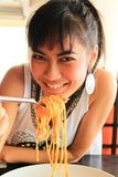 Asian woman eating spaghetti Royalty Free Stock Photo