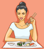Asian woman eating sushi rolls Stock Photography