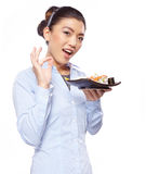 Asian woman eating sushi. Shallow depth of field, focu Stock Photo