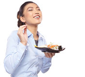 Asian woman eating sushi. Shallow depth of field, focu Stock Image