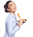 Asian woman eating sushi. Shallow depth of field, focu Stock Photos