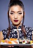 Asian woman eating sushi, Stock Photography