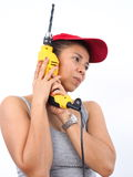 Asian woman with electric drill Royalty Free Stock Photography