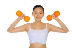 Asian woman engaged in fitness of oranges Royalty Free Stock Photos