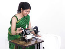 Asian woman engaged in sewing Royalty Free Stock Photography