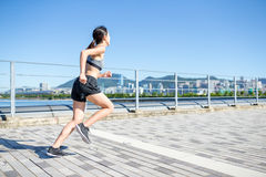 Asian Woman enjoy city running. Asian young woman at outdoor Royalty Free Stock Image