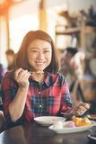 Asian woman enjoy eating mango and sticky rice . Royalty Free Stock Photo