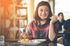 Asian woman enjoy eating mango and sticky rice . Royalty Free Stock Image
