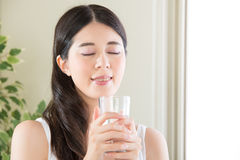 Asian woman enjoy the freshness of clean water from perfect envi Royalty Free Stock Photo