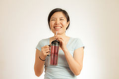 Asian woman enjoy her drink Stock Photos