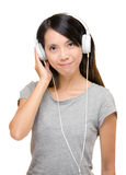 Asian woman enjoy music with earphone Stock Photos
