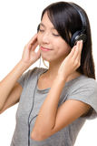 Asian woman enjoy music with earphone Royalty Free Stock Image