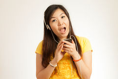 Asian woman enjoy music Royalty Free Stock Image