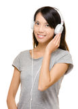 Asian woman enjoy music Royalty Free Stock Images