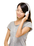 Asian woman enjoy the music Stock Image