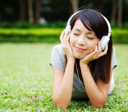 Asian woman enjoy music Stock Images