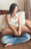An Asian woman enjoy relaxing on a sofa Stock Photos