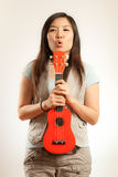 Asian woman enjoy Ukulele Stock Images