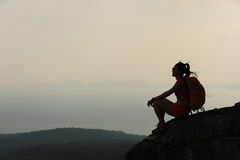 Asian woman enjoy the view at sunset mountain peak Stock Photo