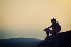 Asian woman enjoy the view at sunset mountain peak Royalty Free Stock Images