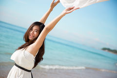 Asian woman enjoying the beach with open arms Royalty Free Stock Photos