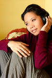 An asian woman enjoying her favorite music Stock Images