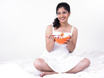 Asian woman enjoying her salad. Young asian woman of indian origin enjoying her salad Stock Photography