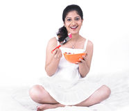 Asian woman enjoying her salad. Young asian woman of indian origin enjoying her salad Stock Photos