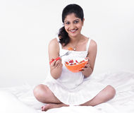 Asian woman enjoying her salad. Young asian woman of indian origin enjoying her salad Royalty Free Stock Image