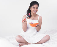 Asian woman enjoying her salad. Young asian woman of indian origin enjoying her salad Stock Images