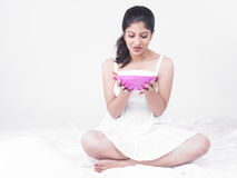 Asian woman enjoying her soup Royalty Free Stock Image