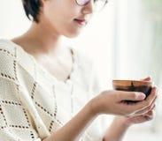 An Asian woman enjoying her tea Stock Photo