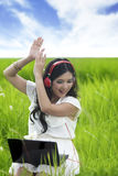 Asian woman enjoying music Stock Photography