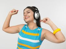 Asian woman enjoying music Stock Image