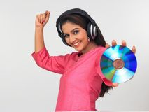 Asian woman enjoying music Stock Photos