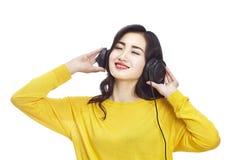 Asian woman enjoying music Royalty Free Stock Photos
