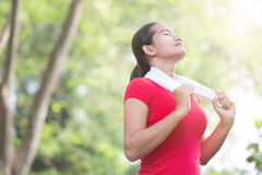 Asian woman enjoying nature after exercising Royalty Free Stock Photography